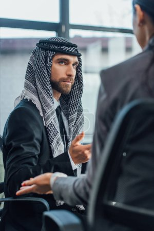 arabic businessman talking with partner on meeting in modern office