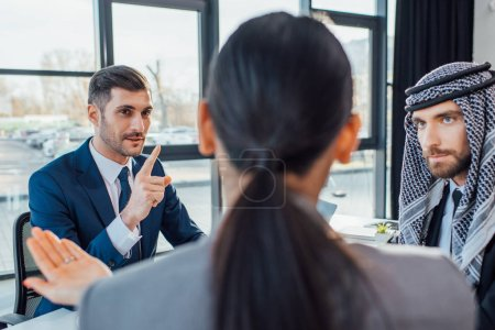 Photo for Professional multicultural business partners discussing contract on meeting in office - Royalty Free Image