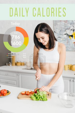 Photo pour Attractive sportswoman smiling and cooking salad with fresh vegetables near daily calories illustration - image libre de droit