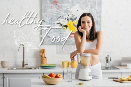 Photo for Slim sportswoman smiling at camera while preparing smoothie near measuring tape on kitchen table and healthy food illustration - Royalty Free Image