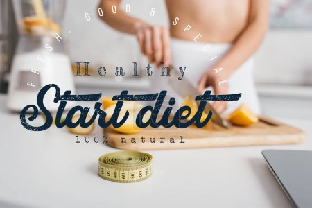 Photo for Selective focus of measuring tape and scales near fit girl cutting fresh fruits for smoothie on kitchen table, start diet illustration - Royalty Free Image