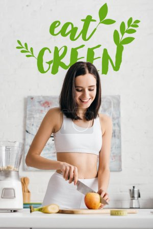 Photo for Selective focus of beautiful smiling sportswoman preparing smoothie with fruits near measuring tape on table, eat green illustration - Royalty Free Image