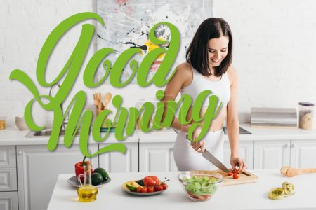 Photo for Attractive woman smiling while cutting organic vegetables near bowl with salad and measuring tape on kitchen table, good morning illustration - Royalty Free Image