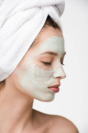 Photo for Attractive girl with nourishing facial mask and towel on head with closed eyes isolated on white - Royalty Free Image