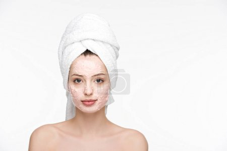 attractive girl with peeling mask on face and towel on head looking at camera isolated on white
