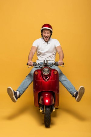 Photo for Happy delivery man in helmet riding scooter on yellow background - Royalty Free Image