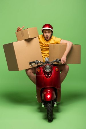 delivery man in yellow uniform on scooter with boxes on green