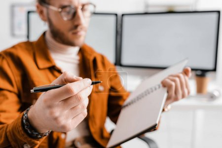 Photo for Selective focus of 3d artist holding pen and notebook in office - Royalty Free Image