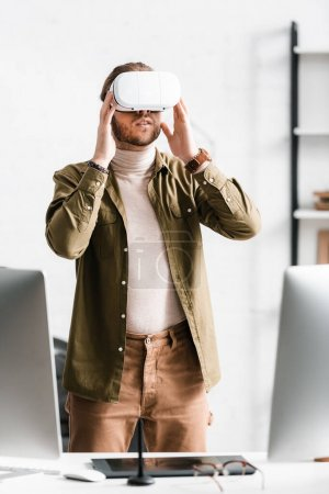 Photo for 3d artist using vr headset while working near computers and graphics tablet on table in office - Royalty Free Image