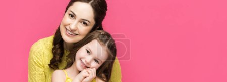 Photo for Panoramic shot of cheerful mother and daughter isolated on pink - Royalty Free Image