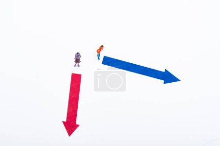 Photo for Top view of two people figures near arrows on white background, concept of equality - Royalty Free Image