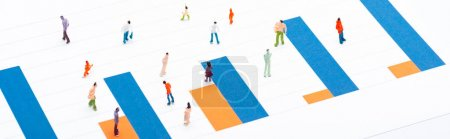 Photo for Concept of equality with people figures on surface with blue and orange diagram isolated on white, panoramic shot - Royalty Free Image