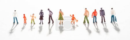 Photo for Panoramic shot of people figures on white surface with shadow - Royalty Free Image