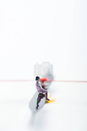 Photo for Selective focus of people figure on arrow of clock on white background with copy space, concept of senescence - Royalty Free Image
