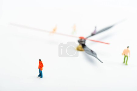 Photo for Selective focus of people figures and black and red arrows of watch on white background, concept of senescence - Royalty Free Image