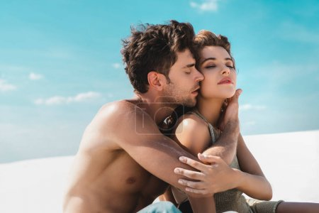 Photo for Passionate sexy young couple hugging on beach - Royalty Free Image