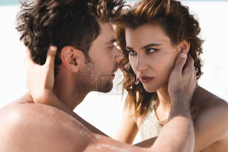 Photo for Passionate sexy young couple looking at each other on beach - Royalty Free Image