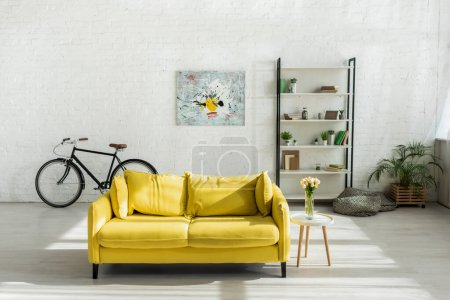 sofa, bicycle and rack in modern living room