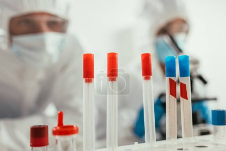 Photo for Selective focus of test tubes near biochemists in laboratory - Royalty Free Image