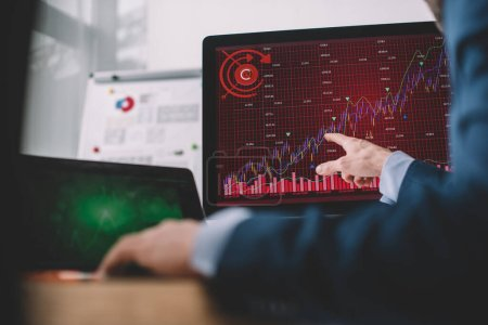 Photo for Selective focus of data analyst pointing with finger at charts on computer monitor at table - Royalty Free Image