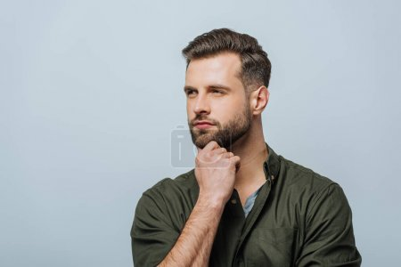 Photo for Confident man with hand near chin looking away isolated on grey - Royalty Free Image