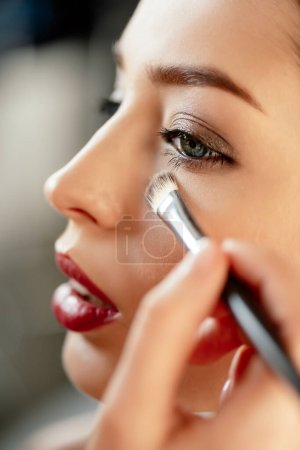 Photo for Selective focus of makeup artist applying concealer on model - Royalty Free Image