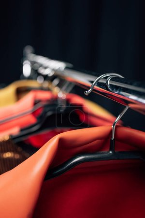 Photo for Close up of hanger with stylish jacket on black - Royalty Free Image