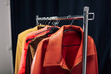 Photo for Selective focus of hanger with stylish jackets in photo studio - Royalty Free Image