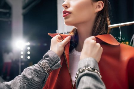 Photo for Cropped view of stylist touching jacket on young model - Royalty Free Image