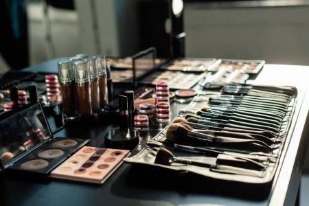 Photo for Selective focus of makeup brush set near decorative cosmetics - Royalty Free Image