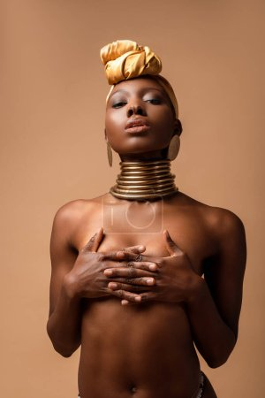 sexy naked tribal afro woman posing isolated on beige