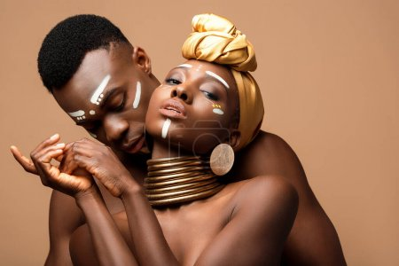 Photo for Sexy naked tribal afro couple posing isolated on beige - Royalty Free Image