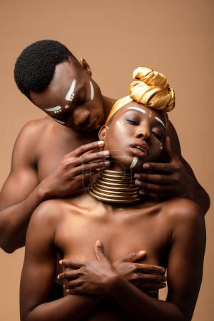 tender naked tribal afro couple posing isolated on beige