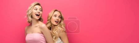 Photo for Panoramic orientation of excited blonde women looking away isolated on pink - Royalty Free Image