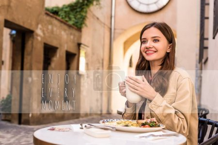 Photo for Selective focus of woman smiling and holding white cup of tea in cafe in city, enjoy every moment illustration - Royalty Free Image