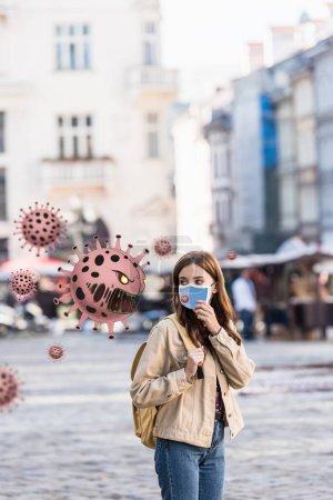 Photo for Beautiful woman in medical mask looking at angry bacteria illustration on street - Royalty Free Image