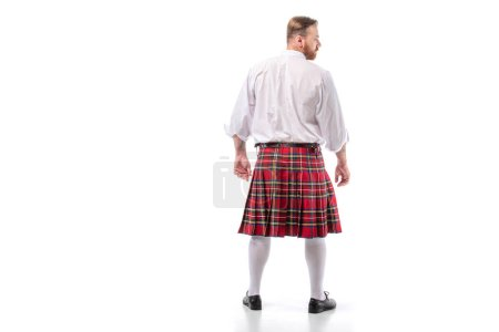 Photo for Back view of Scottish redhead man in red kilt on white background - Royalty Free Image
