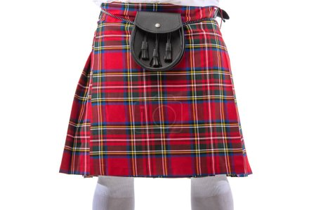 Cropped view of Scottish man in red kilt with leat...
