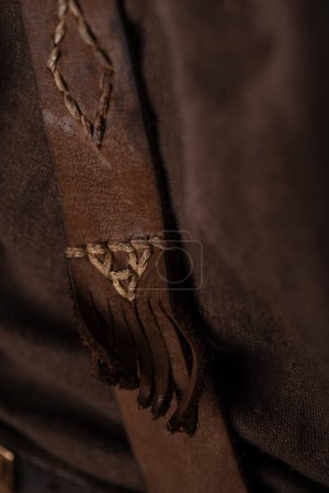 close up view of medieval Scottish brown leather clothing