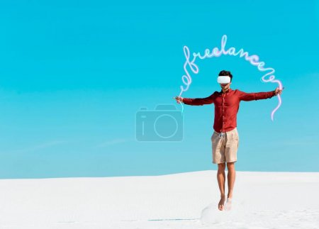 man on sandy beach in vr headset jumping against clear blue sky, freelance illustration