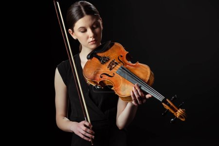 Photo for Beautiful musician playing symphony on violin isolated on black - Royalty Free Image