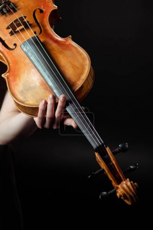 Photo for Cropped view of female musician playing symphony on violin isolated on black - Royalty Free Image
