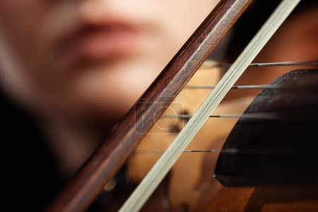 Photo for Cropped view of female musician playing on violin, selective focus - Royalty Free Image