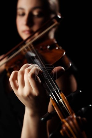 Photo for Selective focus of female musician playing symphony on violin isolated on black - Royalty Free Image