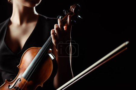 Photo for Partial view of female musician playing on violin isolated on black - Royalty Free Image