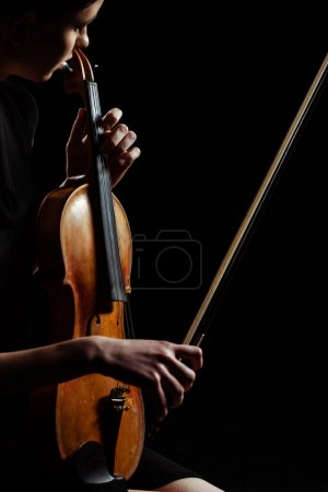 Photo for Attractive musician playing symphony on violin isolated on black - Royalty Free Image