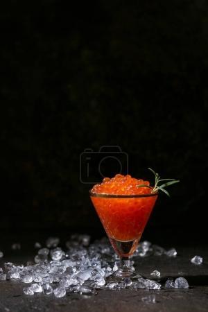 Glass of red caviar