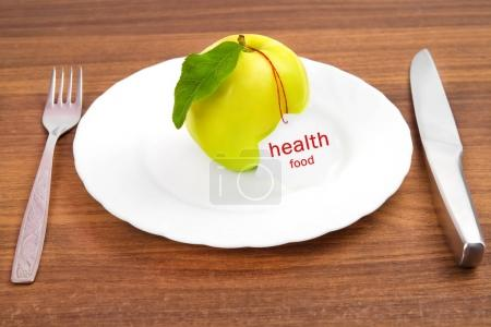 dieting and healthy food. Yellow, green apple with leaf and whit