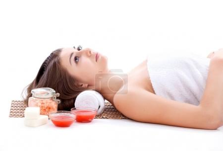 Girl with face mask on a stone therapy, hot stone massage