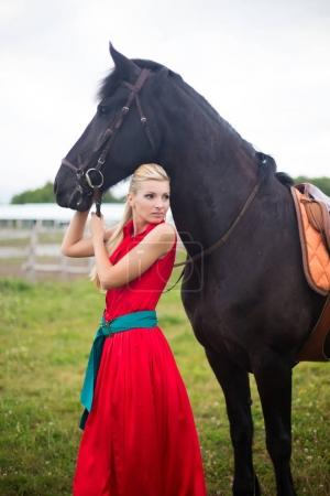 Young cute woman in saturate long dress with black strong and mu
